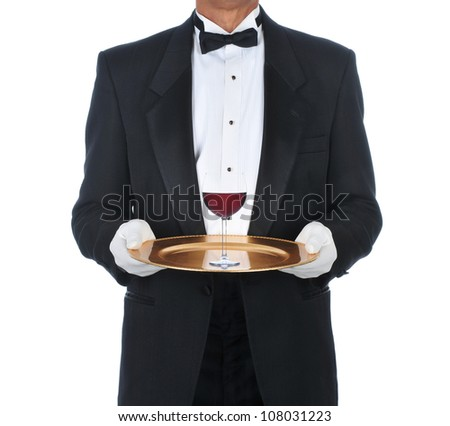 Waiter Wearing Tuxedo Holding Tray with a glass of red wine. Square Format over a white background. - stock photo