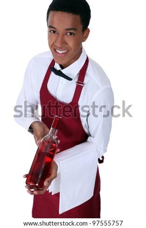 Waiter with bottle of rose wine - stock photo