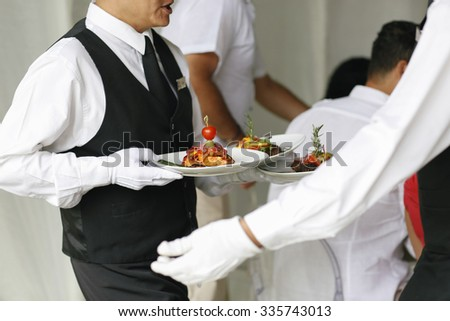 waiter with food - stock photo