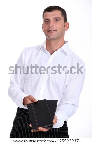 Waiter with menus - stock photo
