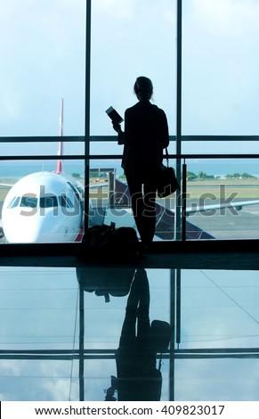 Waiting at the airport terminal - stock photo