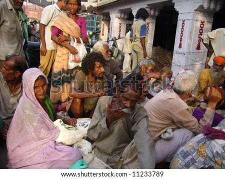 Waiting for alms outside temple in Old Delhi, India - stock photo