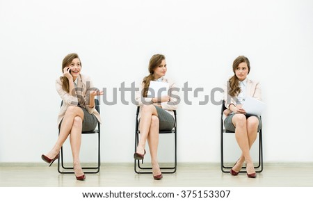 Waiting for interview. Digital composite of young businesswoman expressing different emotions while holding paper  or cellphone and sitting at the chair against white wall - stock photo