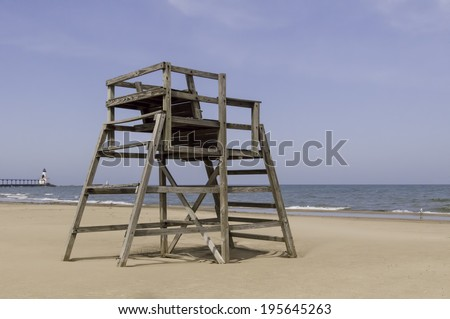 Waiting for summer: Vacant lifeguard tower on sandy beach by Lake Michigan in spring, South Haven, Michigan, USA - stock photo