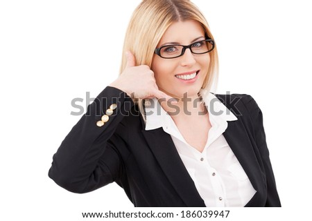 Waiting for your call! Cheerful mature businesswoman gesturing phone sign and smiling while standing isolated on white - stock photo
