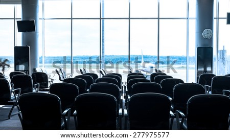 Waiting lounge in airport - stock photo