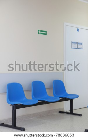 waiting room - blue chairs, door - stock photo