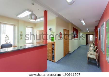 Waiting room with reception in medical clinic - stock photo