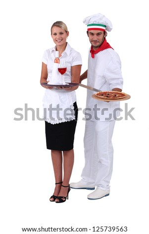 Waitress and cook pizzas - stock photo