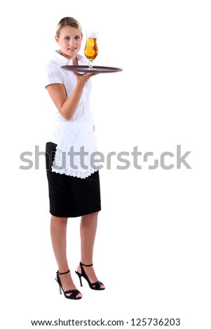 Waitress carrying beer on tray - stock photo