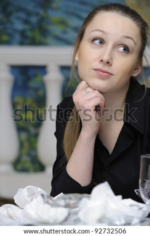 waitress dreams of the table with dirty dishes - stock photo