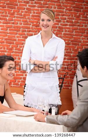 Waitress in a restaurant - stock photo