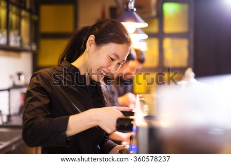 waitress serving in modern cafe - stock photo