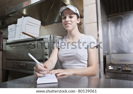 Waitress taking order in a fast food restaurant - stock photo