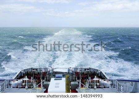 Wake of a ferry boat crossing the North Sea - stock photo