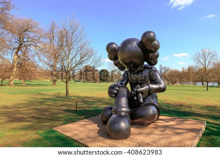WAKEFIELD, YORKSHIRE, UK - APRIL 19TH 2016:  'Better Knowing' Sculpture by the renowned American artist KAWS exhibited at the Yorkshire Sculpture Park. - stock photo