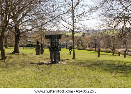 WAKEFIELD, YORKSHIRE, UK - APRIL 19, 2016: The Family of Man, a group of 9 individual bronze sculptures was one of Barbara Hepworths final works, completed in 1970 exhibited in YSP. - stock photo