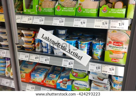 WALDFEUCHT, GERMANY - MAY 11, 2016: Label in German for Lactose free refrigerated fresh products, for Lactose intolerance in a REWE supermarket. Lactose intolerance is the inability to digest lactose. - stock photo