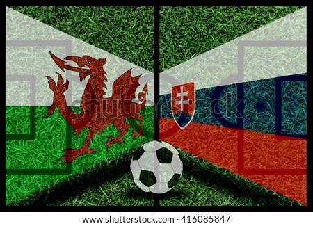 Wales vs Slovakia football flag background on green pitch 2016 - stock photo