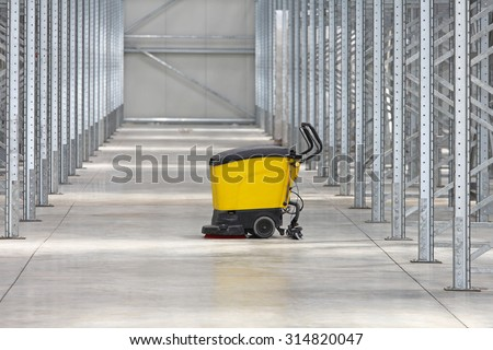 Walk Behind Scrubber Machine For Cleaning Warehouse Floor - stock photo