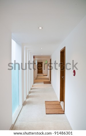 walk way corridor of white color building - stock photo