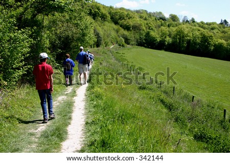Walkers in the countryside - stock photo