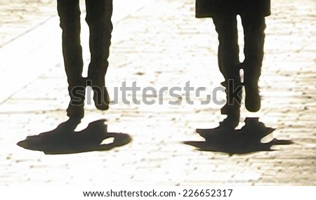 Walkers. Silhouetted legs with shadow, abstract digital pen sketch, based on photo. - stock photo