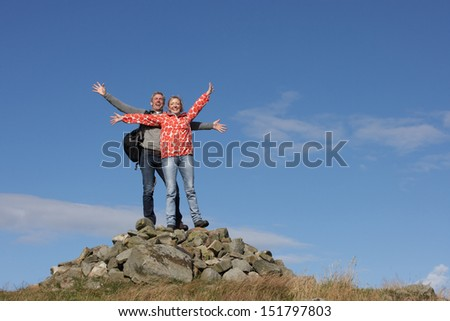 Walkers Standing On Pile Of Rocks - stock photo