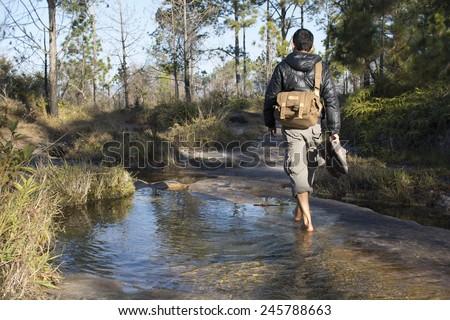 Walking across brook - stock photo