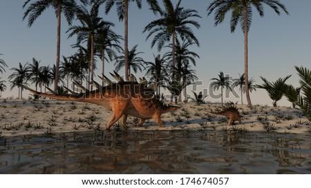 walking adult and young kentrosaurus - stock photo