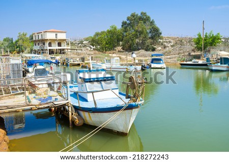 Walking along the river it's easy to find many old boats, moored next to the banks, Liopetri, Cyprus. - stock photo