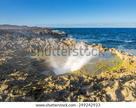 Walking around Boca Patrick and the natural Jacuzzi - Curacao a tropical island in the Caribbean Ocean - stock photo