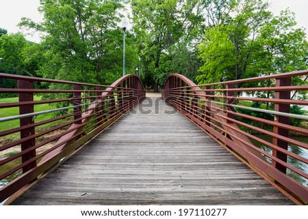 Walking bridge in park on riverfront in Columbus, Georgia - stock photo