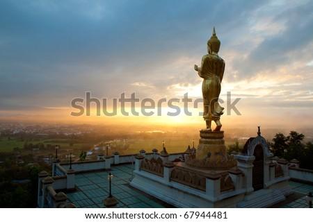 Walking Buddha statue at northern of thailand - stock photo