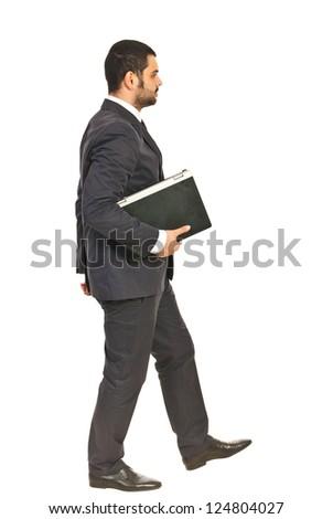 Walking business man holding laptop isolated on white background - stock photo