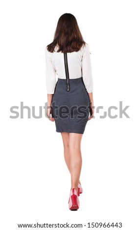walking business woman. back view. going young girl in formal dress with zipper. Rear view people collection.  back side view of person.  Isolated over white background. - stock photo