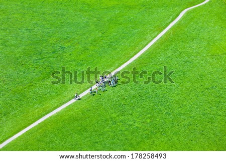 Walking footpath in green field. Horizontal shot - stock photo