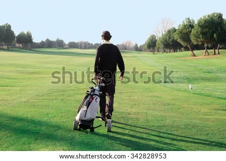 Walking golf course - stock photo