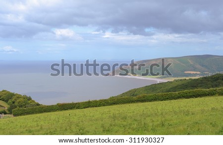 Walking in Exmoor National Park above Porlock Weir with Views across to Hurlstone Point, the Bristol Channel and Wales in the Distance, on the North Coast of Somerset, England, UK - stock photo