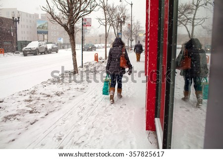 walking in snow. Blizzard - stock photo