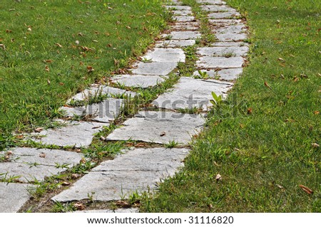 Walking on a stone footpath garden - stock photo
