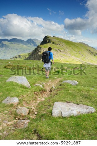 Walking on Red Pike in the English Lake District - stock photo