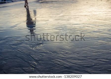 walking on sunset beach - stock photo