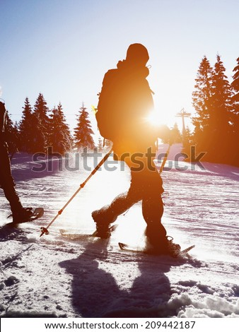 walking on the snow in the mountains - stock photo