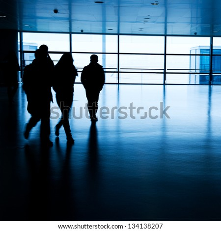 Walking passenger at the airport, motion blur. - stock photo