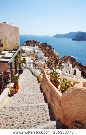 Walking path in Oia with caldera view. Santorini, Greece. - stock photo