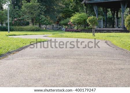 Walking path in park at sunny day of Bangkok city, Thailand - stock photo