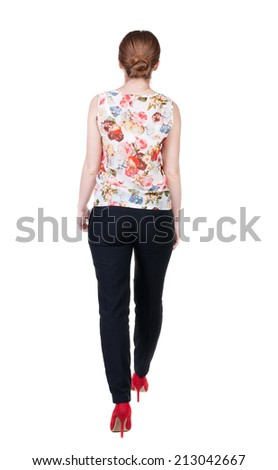 walking red head business woman. back view. going young girl in  suit. Rear view people collection.  back side view of person.  Isolated over white background. - stock photo