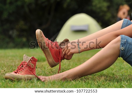 Walking Shoes on - Woman puts her walking shoes on - stock photo