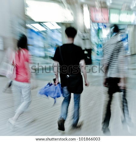 walking shopper people on the street, blur motion - stock photo